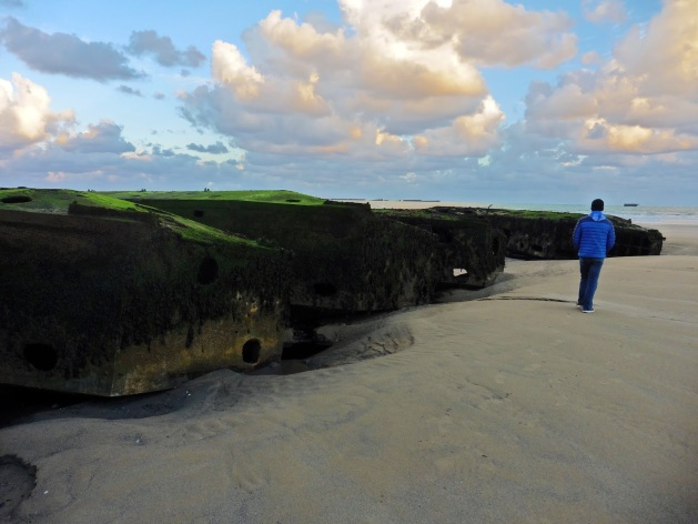Mulberry harbor pieces on Gold Beach in Arromanches-les-Bains