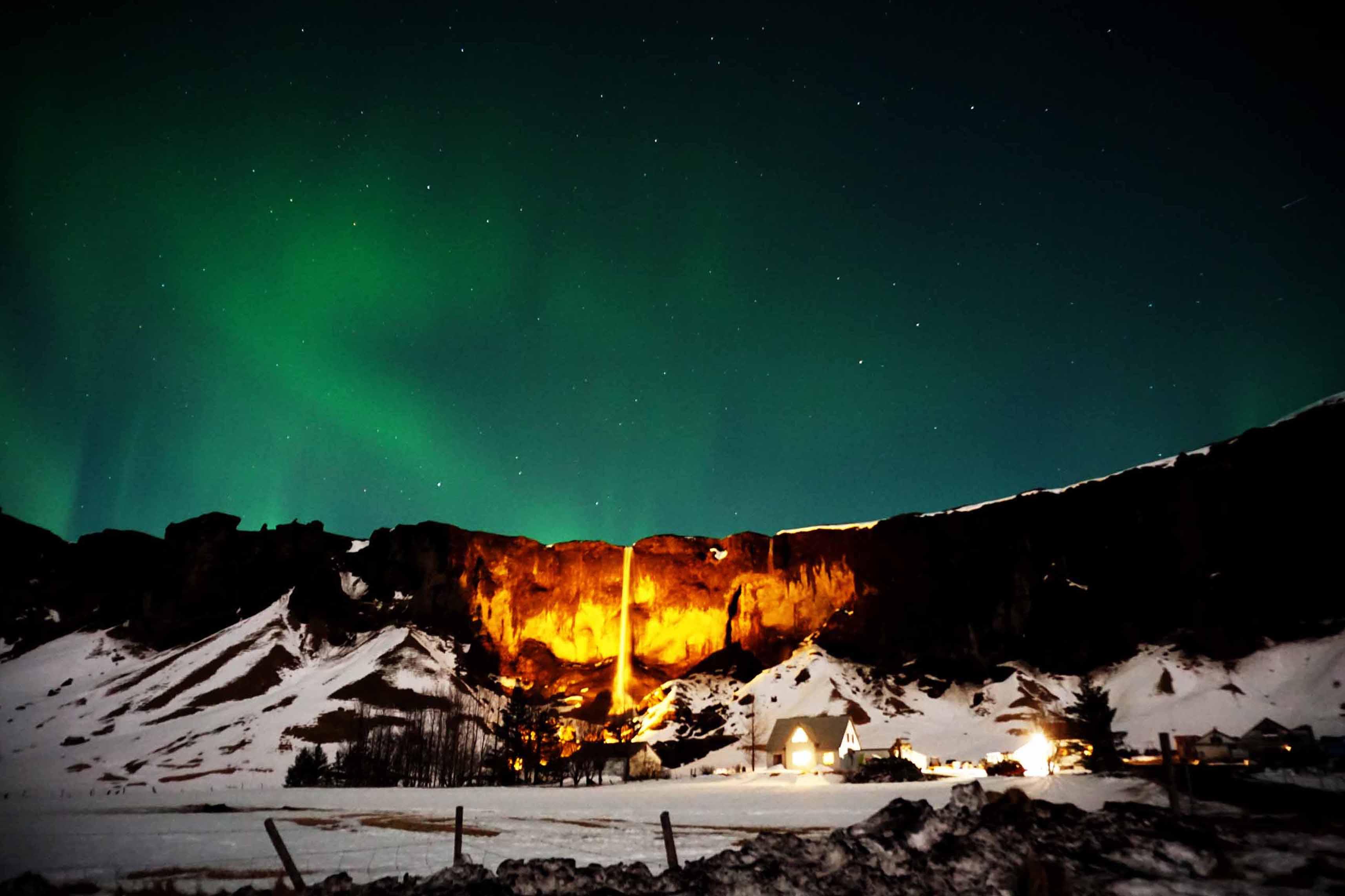 Northern Lights over the Foss á Síðu waterfall in Iceland
