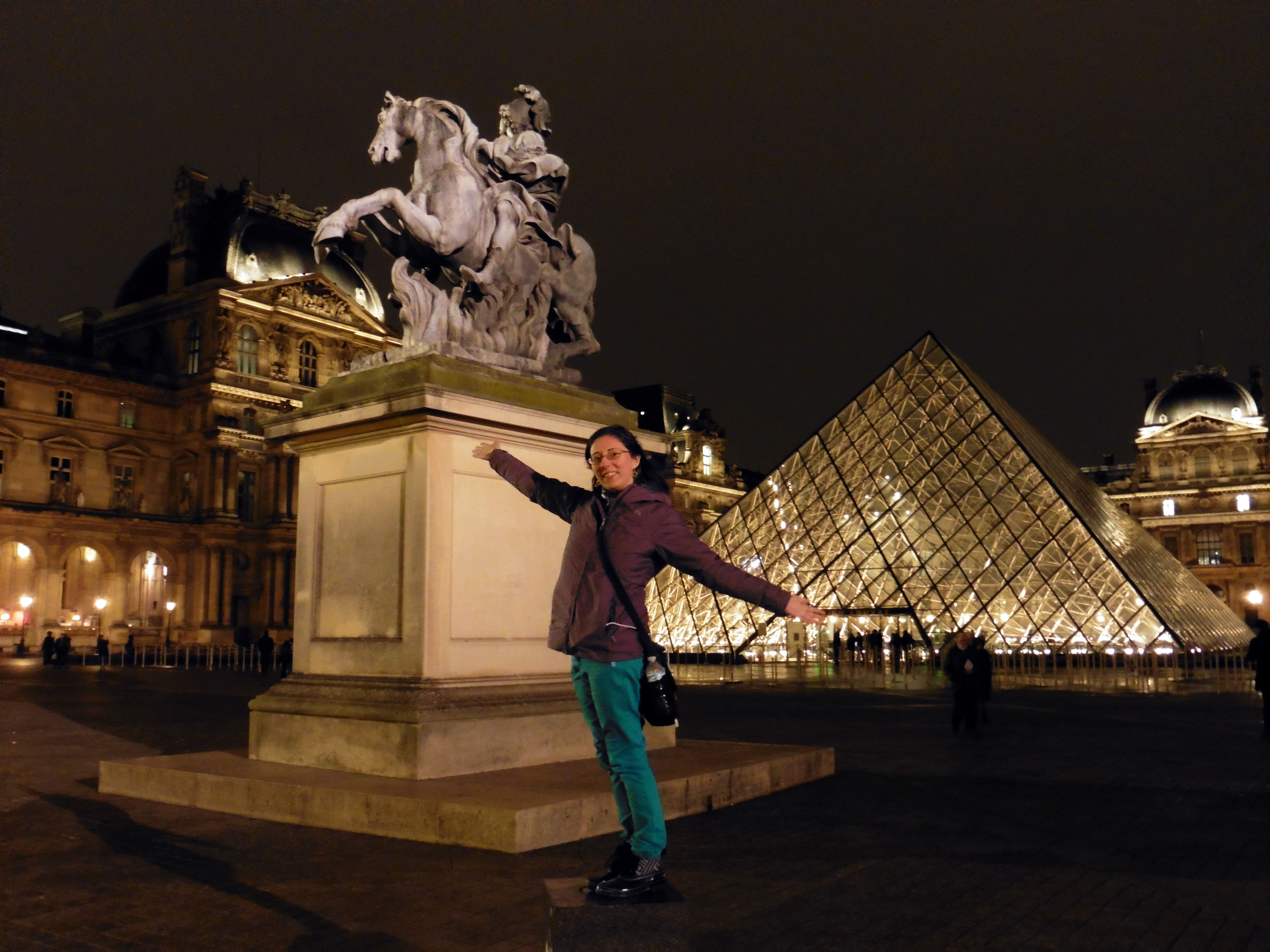 The Louvre pyramid at night in Paris, France
